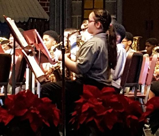 6th Grade Band played Jingle Bells, Jolly Old St. Nicholas, The Dreidel Song, and Kwanzaa Celebration