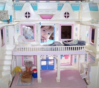 Playing with my doll house from Aunt Mary.