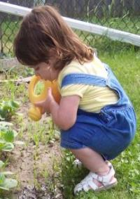 Helping Mommy water plants.