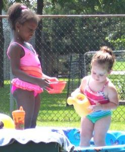 Playing in my pool with my neighbor, Erin.