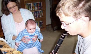 Charles plays his clarinet for me.